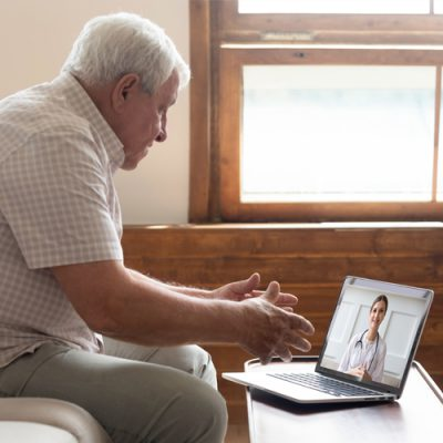 patient at telehealth appointment via computer